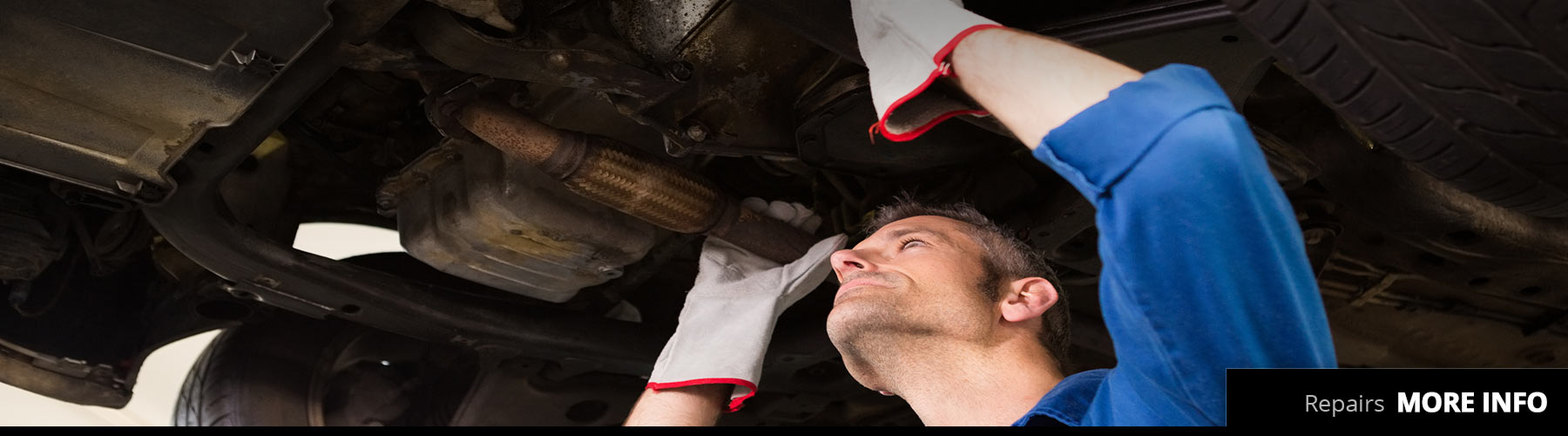 Machanic holding exhaust to repair vehicle